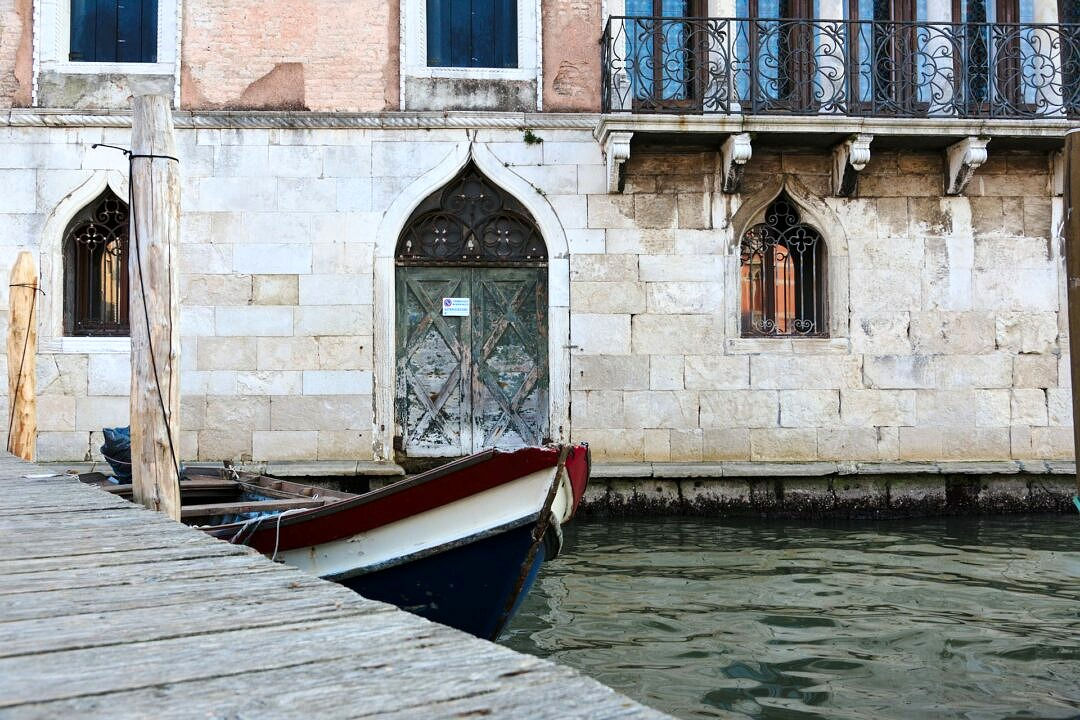 Boat moored in central Venice in front of ancient palace