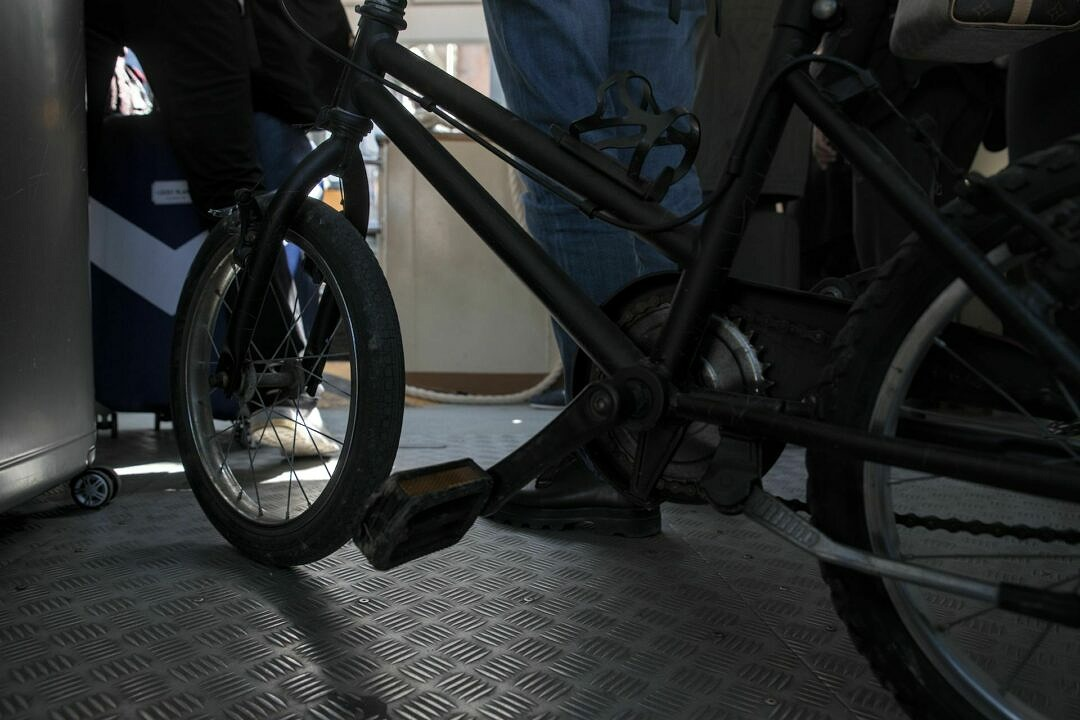 A childrens bicycle in a vaporetto from a dog's point of view