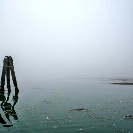 The Venetian lagoon on the fog - briccola with reflection